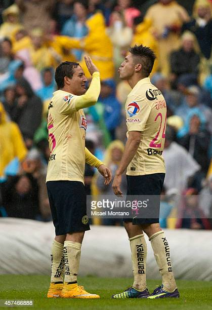 Oribe Peralta of America celebrates after scoring the second goal of his team during a match between America and Monterrey as part of 13th round...