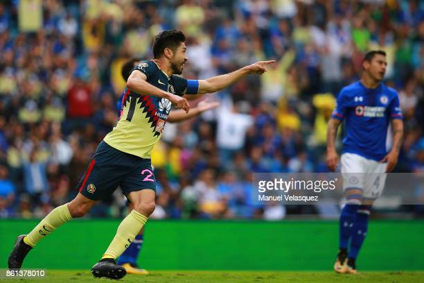 Oribe Peralta of America celebrates after scoring the second goal of his team during the 13th round match between Cruz Azul and America as part of...
