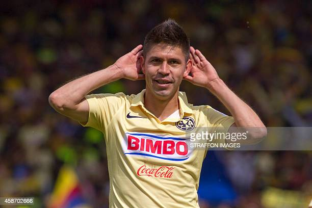 Oribe Peralta of America celebrates after scoring the second goal against Toluca during a match between Toluca and America as part of 16th round...