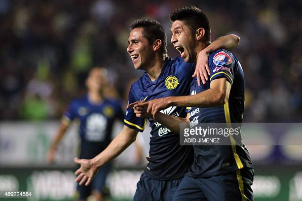 Oribe Peralta of America celebrates his goal against Morelia with his teammate Paul Aguilar during their Mexican Apertura 2015 tournament football...