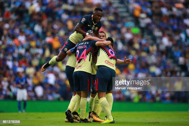 Oribe Peralta of America celebrates with his teammates after scoring the second goal of his team during the 13th round match between Cruz Azul and...