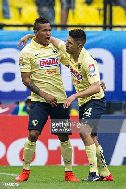Oribe Peralta of America celebrates with Michael Arroyo after scoring during a match between America and Cruz Azul as part of 12th round Clausura...
