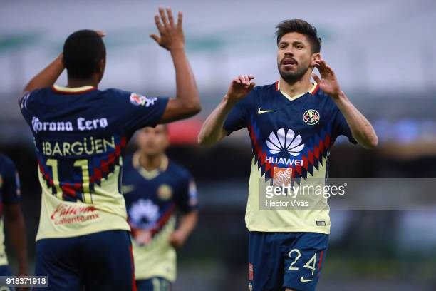 Oribe Peralta of America celebrates with teammate Andres Ibarguen after scoring the fourth goal of his team during the 7th round match between...