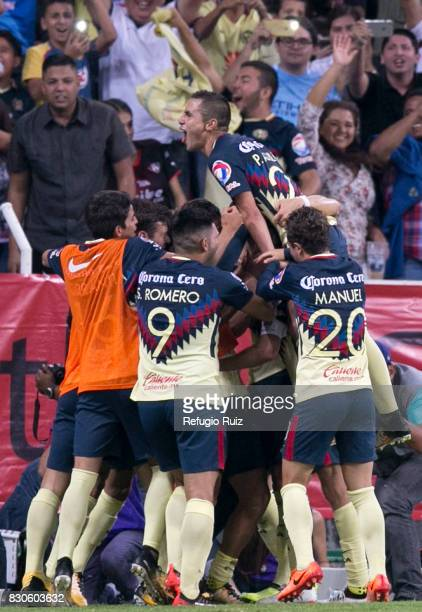Oribe Peralta of America celebrates with teammates after scoring the first goal of his team during the 4th round match between Atlas and America as...