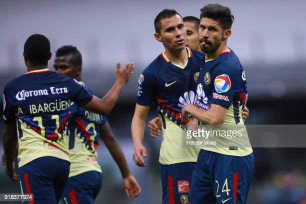Oribe Peralta of America celebrates with teammates after scoring the fourth goal of his team during the 7th round match between America and Monarcas...