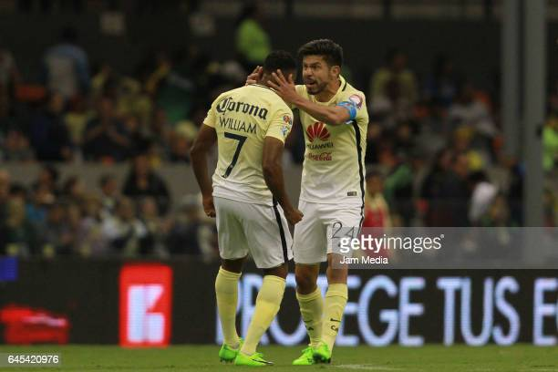 Oribe Peralta of America celebrates with William after scoring his team's first goal during the 8th round match between America and Cruz Azul as part...