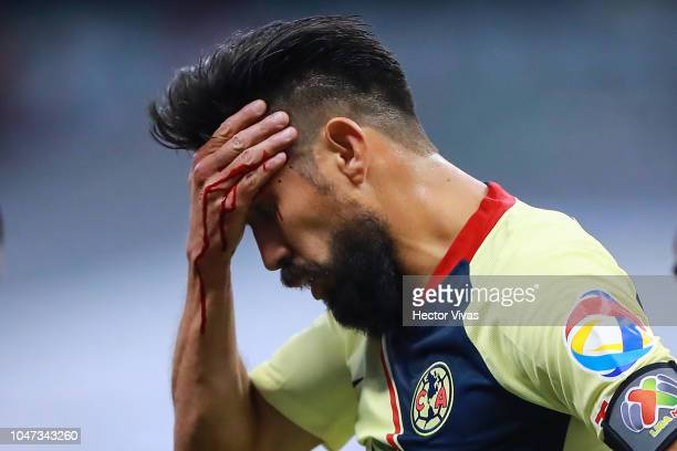 Oribe Peralta of America reacts after a head injury during the 11th round match between America and Chivas as part of the Torneo Apertura 2018 Liga...