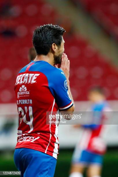 Oribe Peralta of Chivas reacts during the match between Chivas and Atlas as part of the friendly tournament Copa GNP por Mexico at Akron Stadium on...