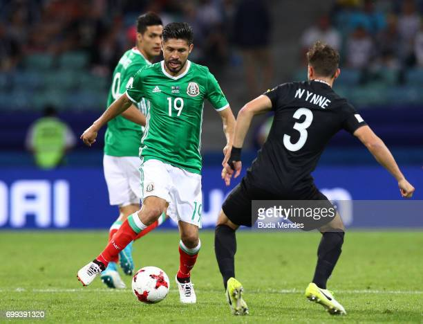 Oribe Peralta of Mexico attempts to take the ball past Deklan Wynne of New Zealand during the FIFA Confederations Cup Russia 2017 Group A match...
