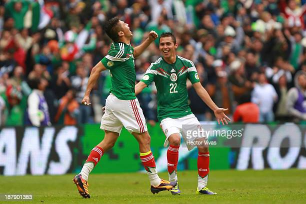 Oribe Peralta of Mexico celebrate with his teammates during a match between Mexico and New Zealand as part of the FIFA World Cup Qualifiers at Azteca...