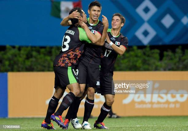 Oribe Peralta of Mexico celebrates a scored goal against Ecuador during a match as part of XVI Pan American Games at Ominilife stadium on October 19,...