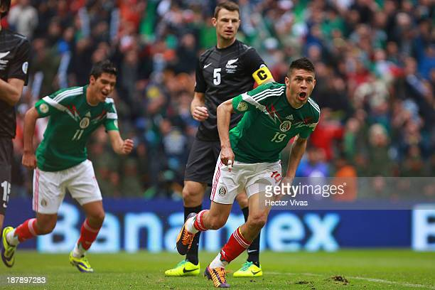 Oribe Peralta of Mexico celebrates a scored goal during a match between Mexico and New Zealand as part of the FIFA World Cup Qualifiers at Azteca...