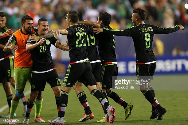 Oribe Peralta of Mexico celebrates after scoring against Jamaica in the second half during the CONCACAF Gold Cup Final at Lincoln Financial Field on...