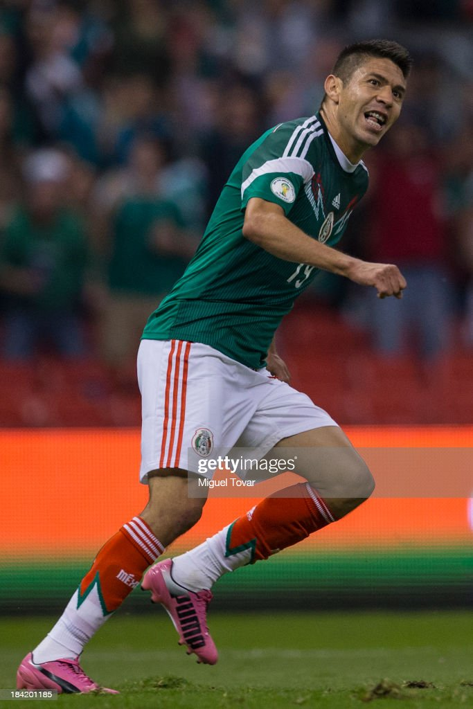 Oribe Peralta of Mexico celebrates after scoring during a match between Mexico and Panama as part of the CONCACAF Qualifyers at Azteca stadium on October 11, 2013 in Mexico City, Mexico.