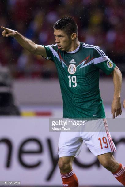 Oribe Peralta of Mexico celebrates after scoring during a match between Costa Rica and Mexico as part of the CONCACAF Qualifiers at National Stadium...
