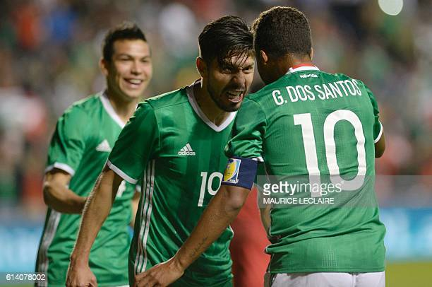 Oribe Peralta of Mexico celebrates his goal with his teammate Giovani Dos Santos against Panama during the friendly football match between the...