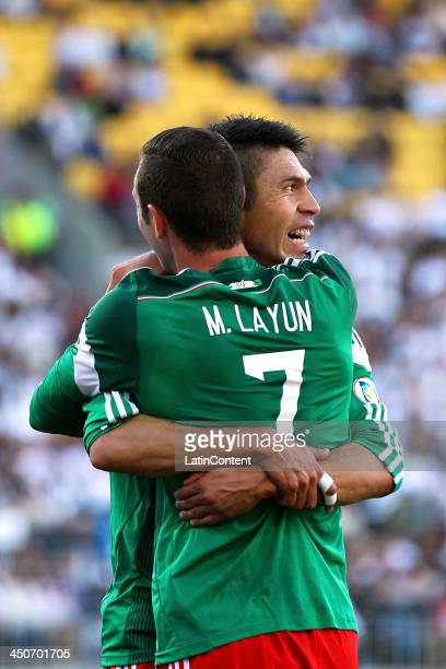Oribe Peralta of Mexico celebrates his goal with teammate Miguel Layun during leg 2 of the FIFA World Cup Qualifier match between the New Zealand All...