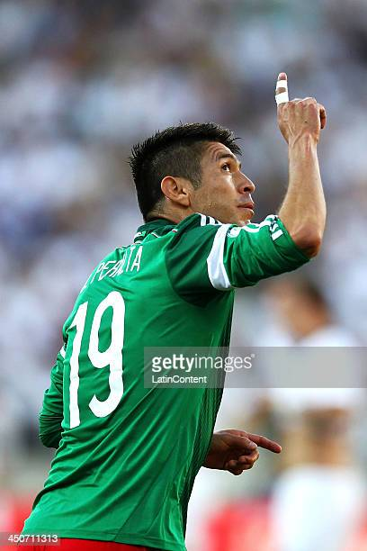 Oribe Peralta of Mexico celebrates scoring a goal during leg 2 of the FIFA World Cup Qualifier match between the New Zealand All Whites and Mexico at...