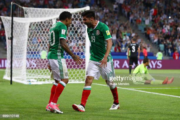 Oribe Peralta of Mexico celebrates scoring his sides second goal with Javier Aquino of Mexico during the FIFA Confederations Cup Russia 2017 Group A...