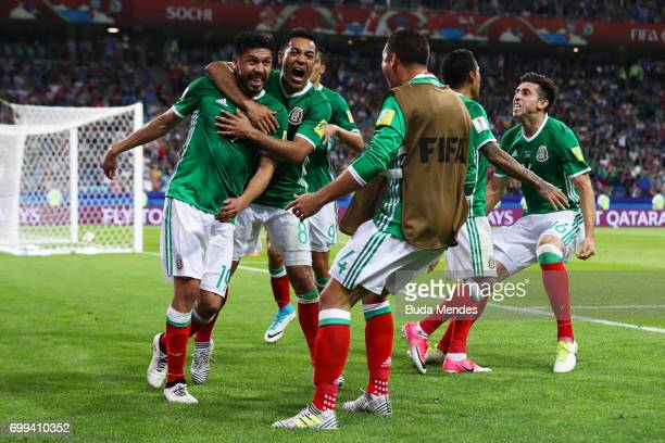 Oribe Peralta of Mexico celebrates scoring his sides second goal with his Mexico team mates during the FIFA Confederations Cup Russia 2017 Group A...
