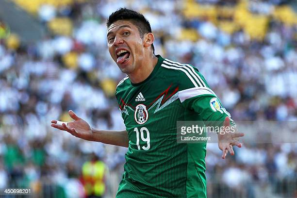 Oribe Peralta of Mexico celebrates scoring the opening goal during leg 2 of the FIFA World Cup Qualifier match between the New Zealand All Whites and...