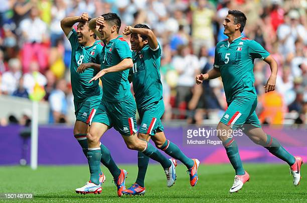 Oribe Peralta of Mexico celebrates scoring the opening goal with his team mates during the Men's Football Final between Brazil and Mexico on Day 15...