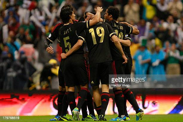 Oribe Peralta of Mexico celebrates with his teamates during a match between Mexico and Honduras as part of the 15th round of the South American...