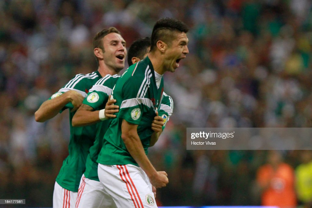 Oribe Peralta of Mexico celebrates with his teammates during a match between Mexico and Panama as part of the CONCACAF Qualifyers at Azteca stadium on October 11, 2013 in Mexico City, Mexico.