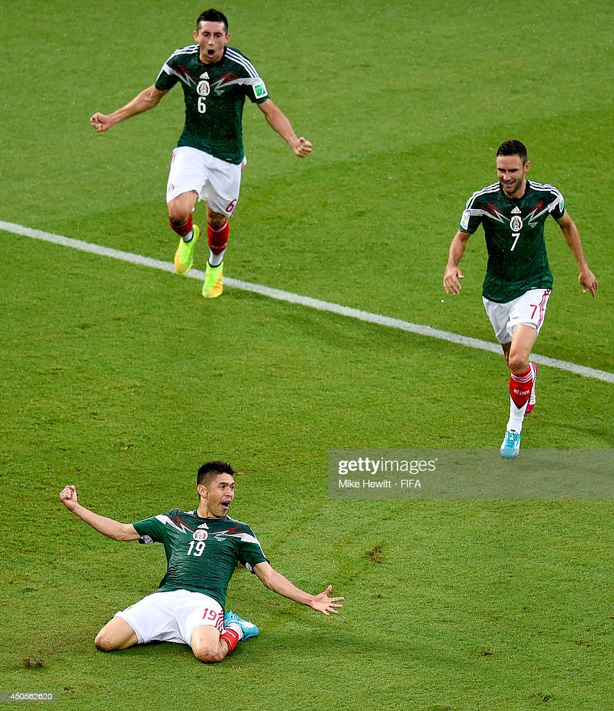 Oribe Peralta of Mexico celebrates with team-mates after scoring a goal during the 2014 FIFA World Cup Brazil Group A match between Mexico and Cameroon at Estadio das Dunas on June 13, 2014 in Natal, Brazil.