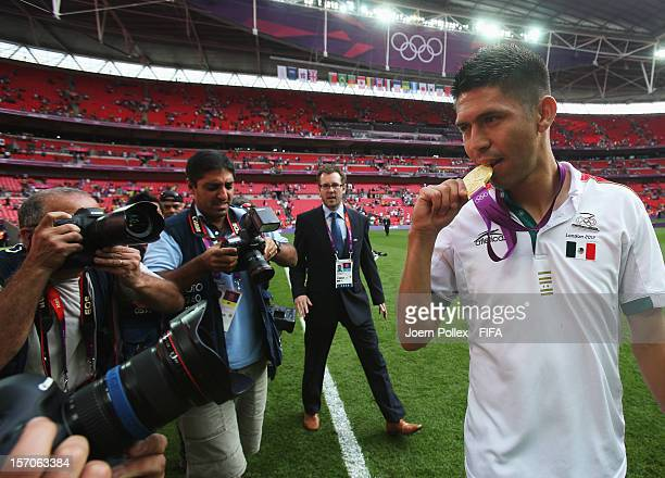 Oribe Peralta of Mexico celebrates with the Gold medal after winning the Men's Football Gold Medal match between Brazil and Mexico at at Wembley...
