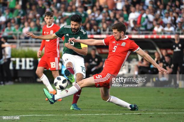 Oribe Peralta of Mexico has his shot blocked by Chris Mepham of Wales during the second half of their friendly international soccer match at the Rose...