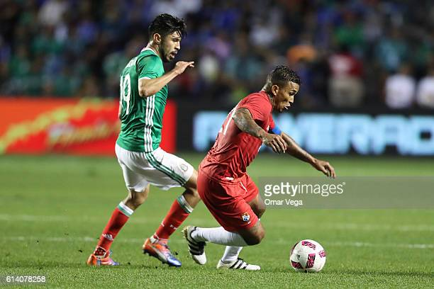 Oribe Peralta of Mexico marks Amilcar Henriquez of Panama during the International Friendly Match between Mexico and Panama at Toyota Park on October...