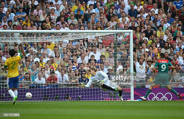 Oribe Peralta of Mexico scores their second goal during the Men's Football Final between Brazil and Mexico on Day 15 of the London 2012 Olympic Games...
