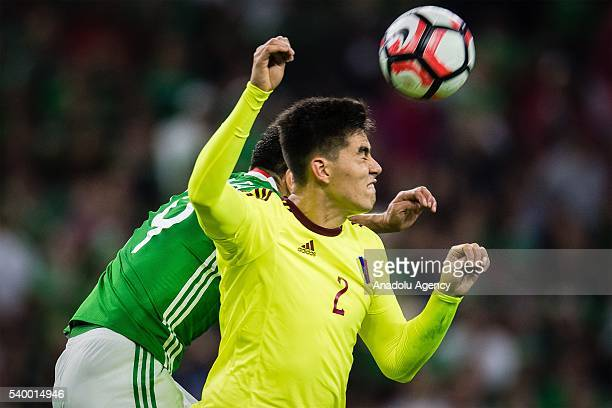 Oribe Peralta of Mexico struggle for the ball against Wilker Angel of Venezuela during the 2016 Copa America Centenario Group C match between Mexico...