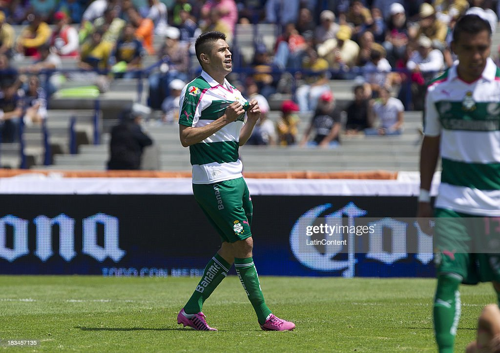 Oribe Peralta of Santos celebrates a scored goal against Pumas during a match between Pumas and Santos as part of the Apertura 2013 Liga MX at Olympic Stadium on October 06, 2013 in Mexico City, Mexico.