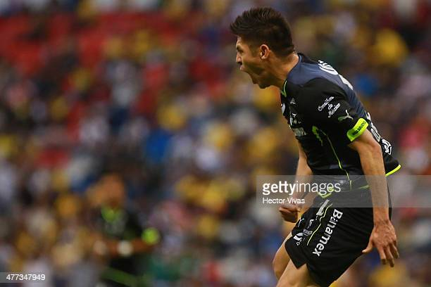 Oribe Peralta of Santos celebrates his first goal and third of Santos during a match between America and Santos Laguna as part of the 10th round...