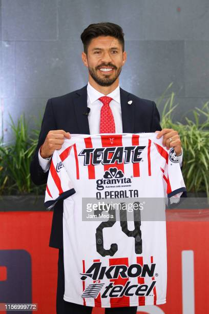 Oribe Peralta poses with Chivas jersey during his unveiling at Akron Stadium on June 19 2019 in Zapopan Mexico