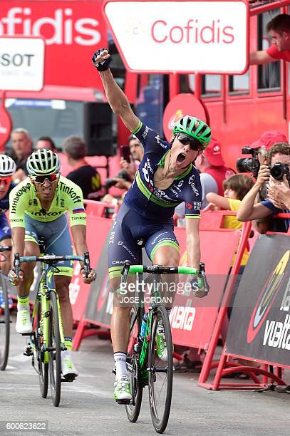 Orica Bikeexchange's Danish cyclist Magnus Cort Nielsen celebrates winning as he crosses the finish line during the 18th stage of the 71st edition of...