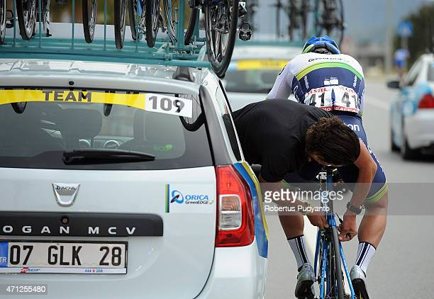 Orica GreenEdge's official fixes Adam Blythe's bicycle while he competes during Stage 1 of the 51st Presidential Cycling Tour of Turkey 2015 Alanya...