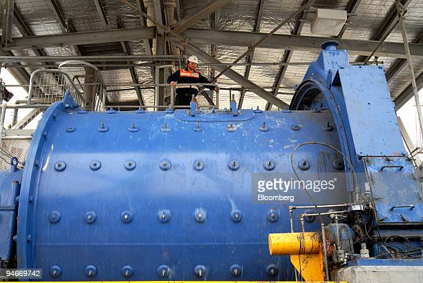 Orica Ltd employee inspects a spinning ball mill containing magnesium hydroxide liquid at the company's special chemicals plant in Deer Park outside...