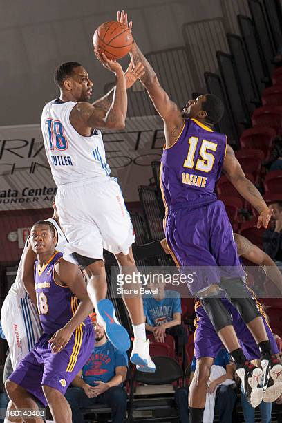 Orien Greene of the Los Angeles DFenders reaches for a shot by Rasual Butler of the Tulsa 66ers during the NBA DLeague game on January 26 2013 at the...
