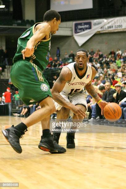 Orien Greene of the Utah Flash drives the ball against Desmon Farmer of the Reno Bighorns during the D-League game on December 11, 2009 at the McKay...