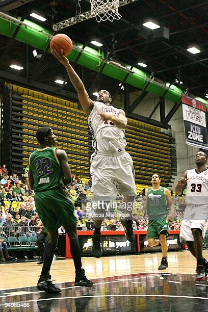 Orien Greene of the Utah Flash lays up a shot against Mo Charlo of the Reno Bighorns during the D-League game on December 11, 2009 at the McKay...
