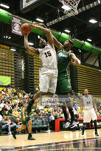 Orien Greene of the Utah Flash puts up a shot against Rod Benson of the Reno Bighorns during the D-League game on December 11, 2009 at the McKay...