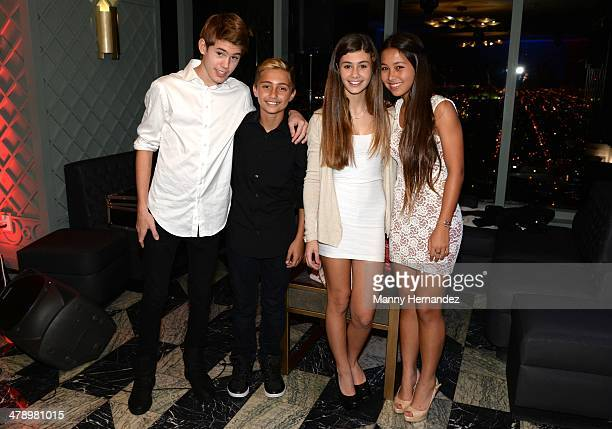 Orienne Collins son Nicholas Collins and bandmates attend Brit Week Miami opening event at the Viceroy Hotel Spa on March 6 2014 in Miami Florida