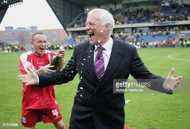 Orient chairman Barry Hearn is sprayed with champagne by Michael Simpson after the Coca-Cola Division 2 match between Oxford United and Leyton Orient...