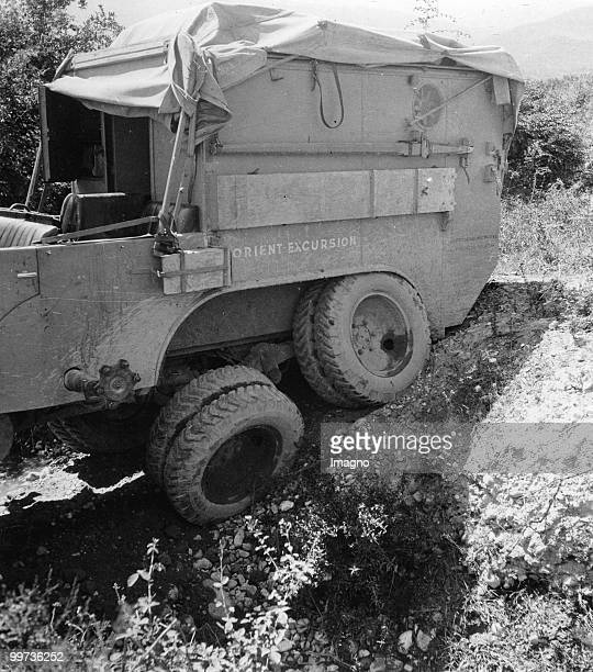 Orient Expedition of the Austrian Mr. Von Kummer: A expedition car is stucked on a rough road. Photograph. Around 1930.