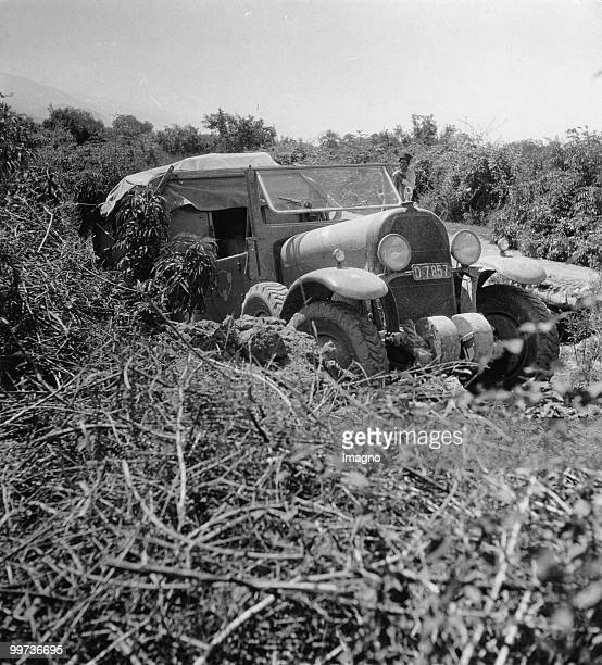 Orient Expedition of the Austrian Mr. Von Kummer: one of the expeditions cars got stuck on a steep road piece. Photograph around 1930.