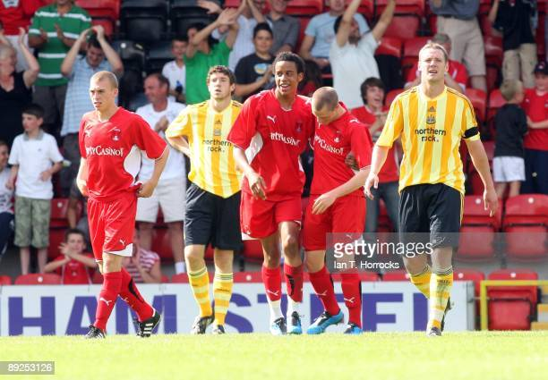 Orient palyers celebrate the fourth home goal during a pre-season friendly match between Leyton Orient and Newcastle United at the Matchroom Stadium...