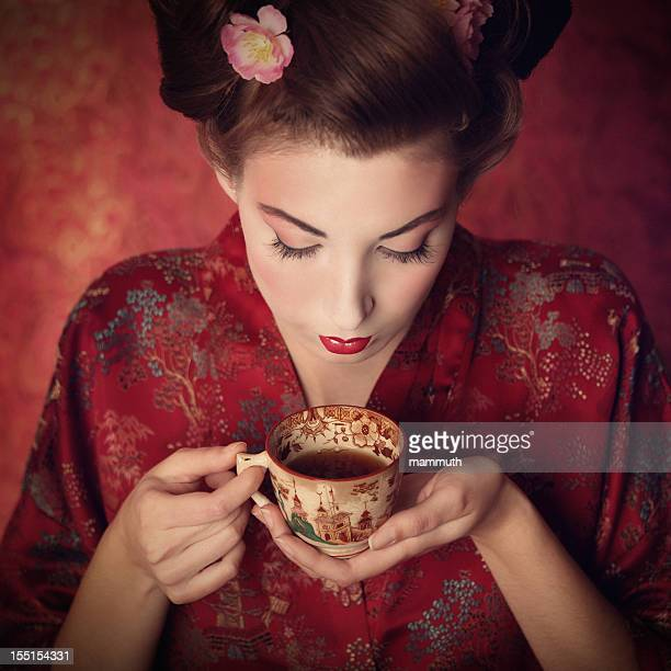 oriental beauty holding a cup of tea